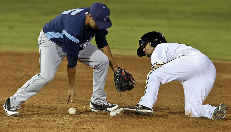 The Missions' Rico Noel steals second base as Corpus Christi's Jiovanni Mier drops the throw Tuesday night at Wolff Stadium. Noel had three steals. Photo: Tom Reel / San Antonio Express-News