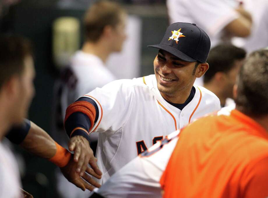 Astros first baseman Carlos Pena tries to keep spirits up in the dugout while sitting out Tuesday night's game at Minute Maid Park. Photo: Karen Warren, Staff / © 2013 Houston Chronicle