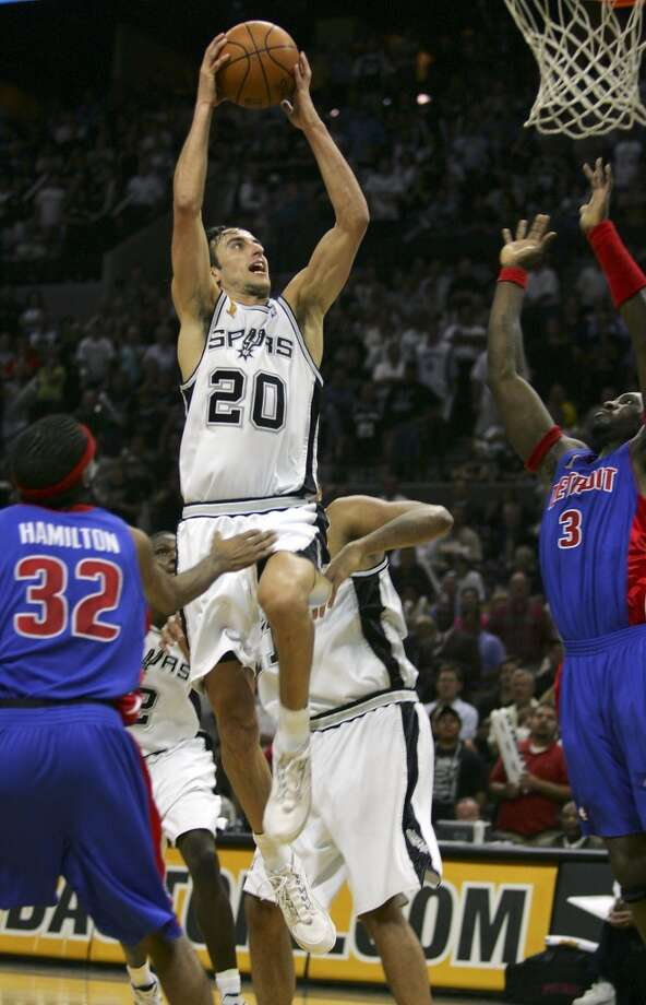 BEST — 2005 NBA FINALS  Moment: Body of work  Victim: Detroit  Note: Could have easily been the MVP after averaging 18.7 points, 5.9 rebounds and 4.0 assists against the rugged Pistons.   PHOTO: Ginobili goes to the basket past the Pistons' Richard Hamilton and Ben Wallace during the fourth quarter of Game 7 of the NBA Finals at the SBC Center on June 23, 2005.