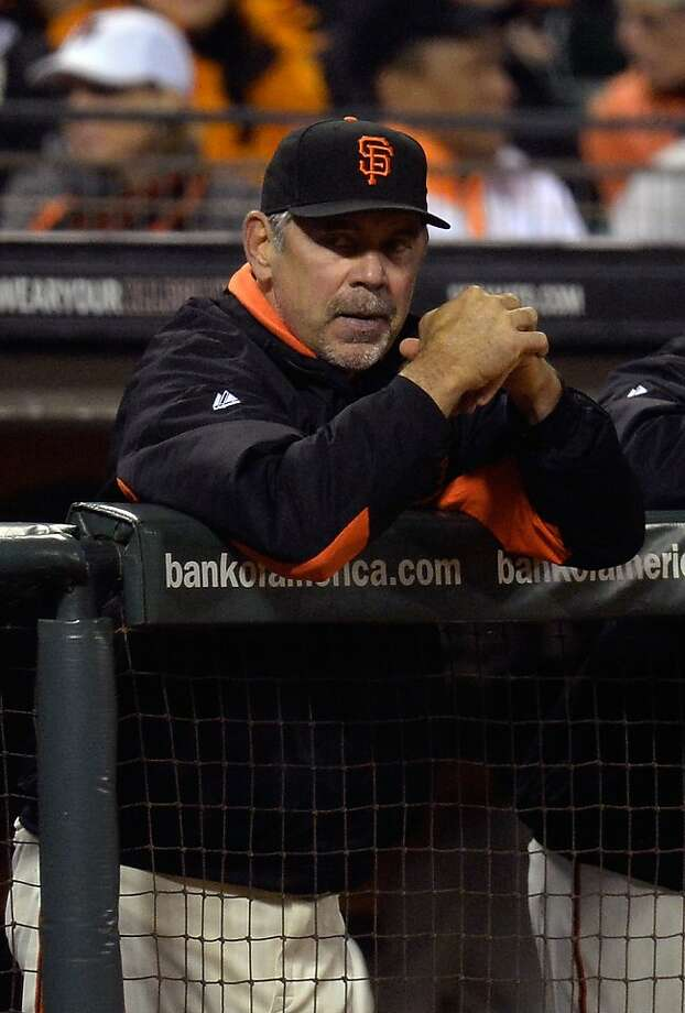 SAN FRANCISCO, CA - MAY 07:  Manager Bruce Bochy #15 of the San Francisco Giants looks on from the dugout against the Philadelphia Phillies in the eighth inning at AT&T Park on May 7, 2013 in San Francisco, California.  (Photo by Thearon W. Henderson/Getty Images) Photo: Thearon W. Henderson, Getty Images