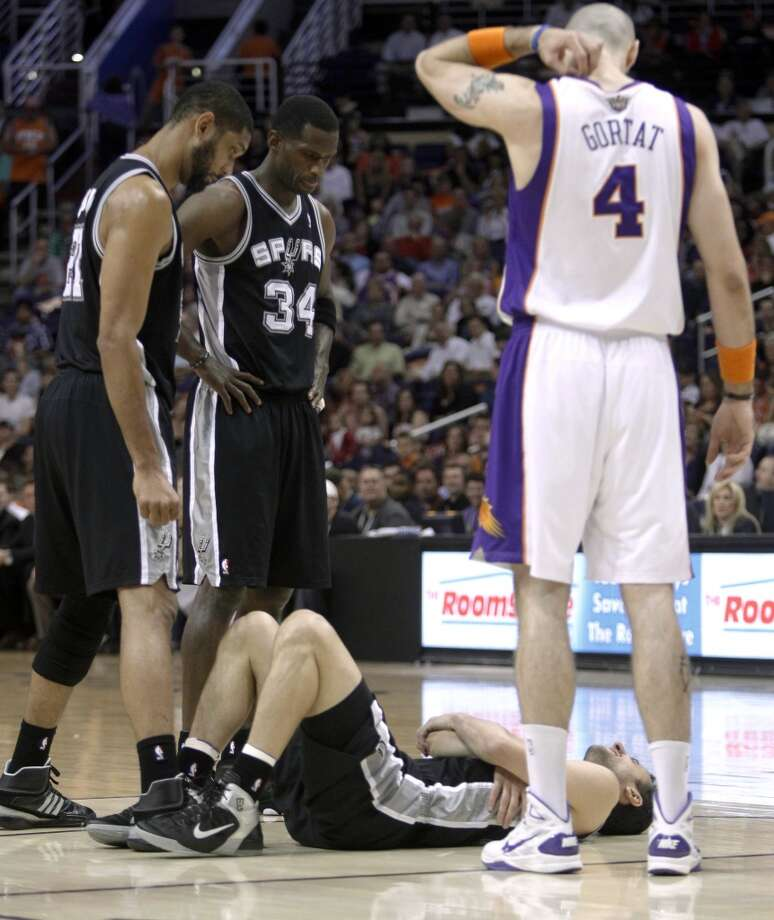 WORST — 2011 FINALE  Moment: Last game of season  Beneficiary: Memphis  Note: OK, so it didn't happen in the playoffs. But his broken arm in a meaningless game at Phoenix illustrated lack of restraint.   PHOTO: Ginobili lies on the court as teammates Tim Duncan and Antonio McDyess (34), and the Suns' Marcin Gortat (4), watch, moments after Ginobili was fouled by the Suns' Grant Hill during the first quarter on April 13, 2011, in Phoenix. Ginobili had to leave the game.