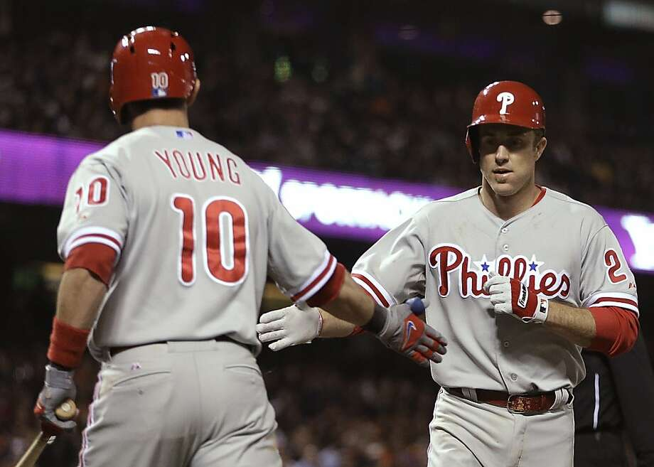 Philadelphia Phillies' Chase Utley, right, is congratulated bu Michael Young (10) after Utley hit a home run off San Francisco Giants' Tim Lincecum in the fifth inning of a baseball game Tuesday, May 7, 2013, in San Francisco. (AP Photo/Ben Margot) Photo: Ben Margot, Associated Press