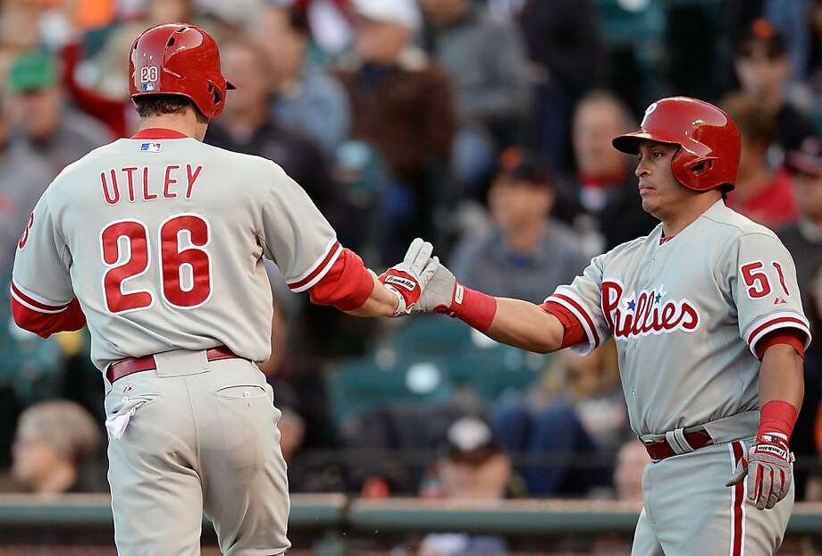 SAN FRANCISCO, CA - MAY 07:  Chase Utley #26 of the Philadelphia Phillies is congratulated by Carlos Ruiz #51 after Utley scored against the San Francisco Giants in the first inning at AT&T Park on May 7, 2013 in San Francisco, California.  (Photo by Thearon W. Henderson/Getty Images) Photo: Thearon W. Henderson, Getty Images