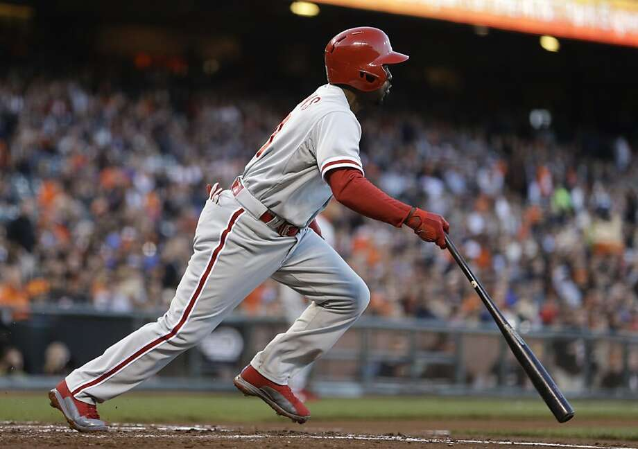 Philadelphia Phillies' Jimmy Rollins runs to first base after hitting an RBI ground out off San Francisco Giants' Tim Lincecum in the second inning of a baseball game Tuesday, May 7, 2013, in San Francisco. (AP Photo/Ben Margot) Photo: Ben Margot, Associated Press
