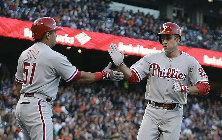 Philadelphia Phillies' Chase Utley, right, is congratulated by Carlos Ruiz (51) after Utley scored against the San Francisco Giants in the first inning of a baseball game Tuesday, May 7, 2013, in San Francisco. (AP Photo/Ben Margot) Photo: Ben Margot, Associated Press