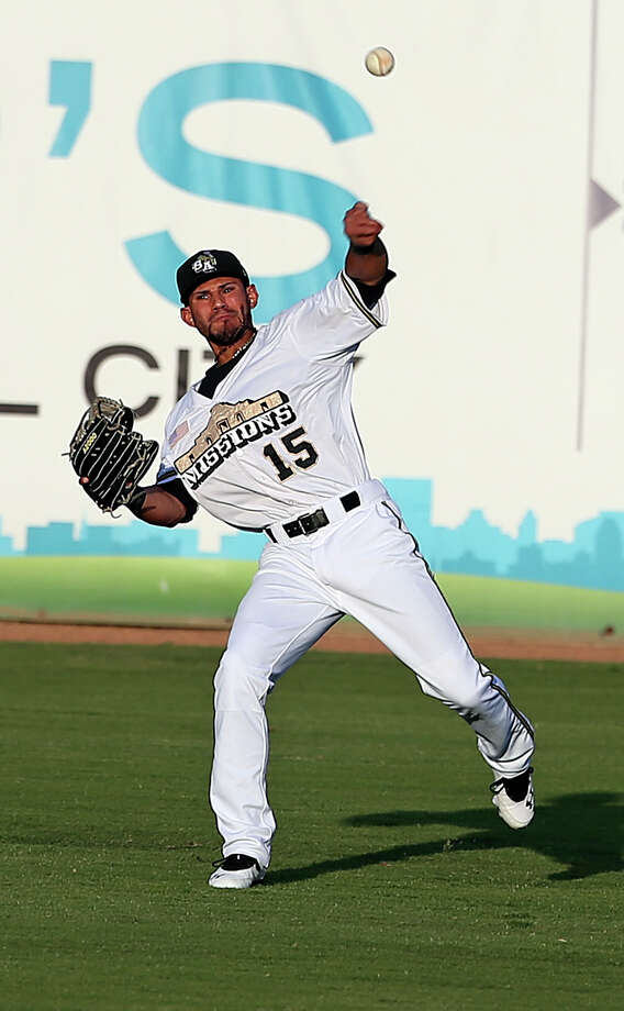 Reymond Fuentes throws to the infield from right field as the Missions host the Hooks  on May 7, 2013. Photo: TOM REEL