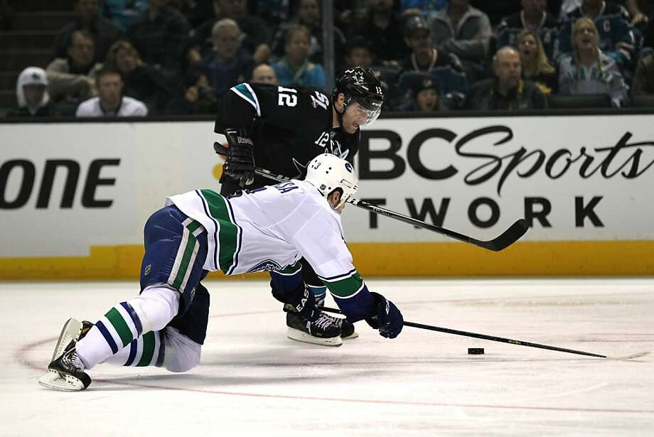 Patrick Marleau (12) of the San Jose Sharks drives the puck up ice in the third period during their NHL play-off game with the Vancouver Canucks at HP Pavilion on Tuesday, May 7, 2013 in San Jose, California. Photo: Lance Iversen, The Chronicle