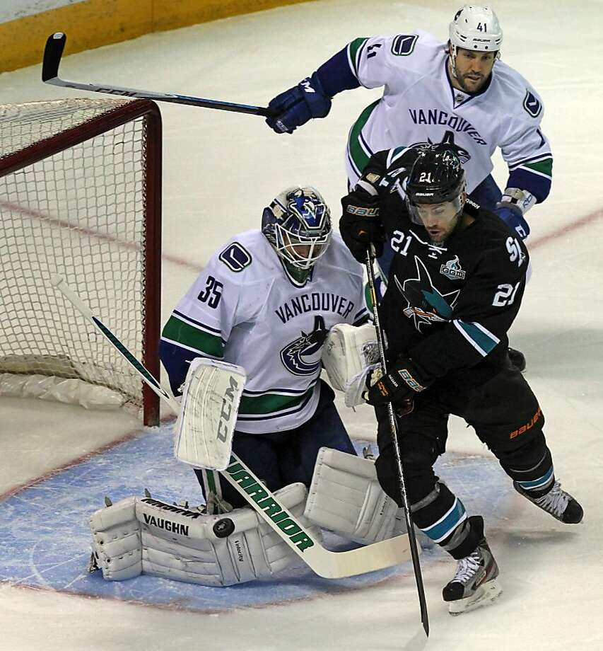 TJ Galiardi (21) of the San Jose Sharks scores a first period goal against Vancouver Canucks goalie Cory Schneider during four of the Stanley Cup playoffs at HP Pavilion on Tuesday, May 7, 2013 in San Jose, California. Photo: Lance Iversen, The Chronicle