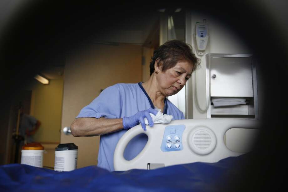 Rosita Saavedra, patient support assistant, uses sani-cloth wipes to clean a hospital room at UCSF Long Hospital on Monday, May 6, 2013 in San Francisco, Calif.