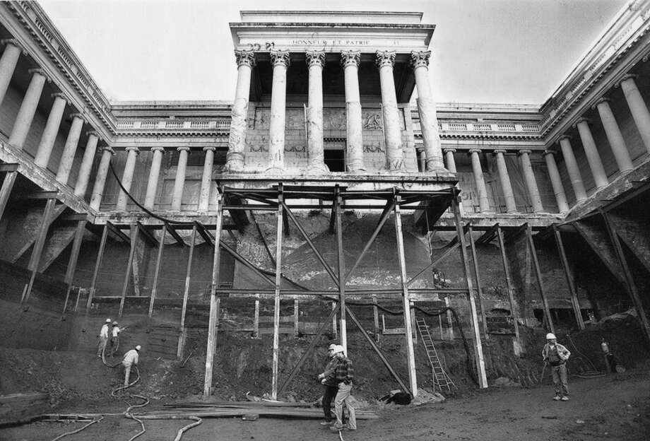 Workmen from Hensel Phelps construction work sixty feet below the main entrance of the California Palace of the Legion of Honor museum January 12, 1994. They are building two additional floors beneath the museum and performing seismic upgrades to the complex.