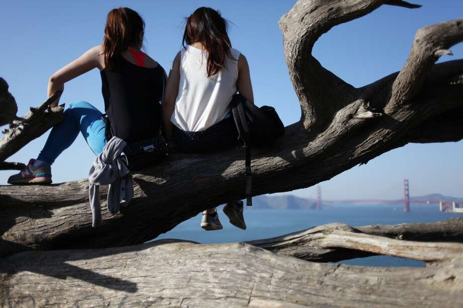 Vanessa Li, left and Karen Lee, take in the view from Dead Man's Point on May 2, 2013 in the Lincoln Heights area of San Francisco, Calif. Lee and Li, both from Hong Kong, are juniors at S.F. State and Academy of Art, respectively.