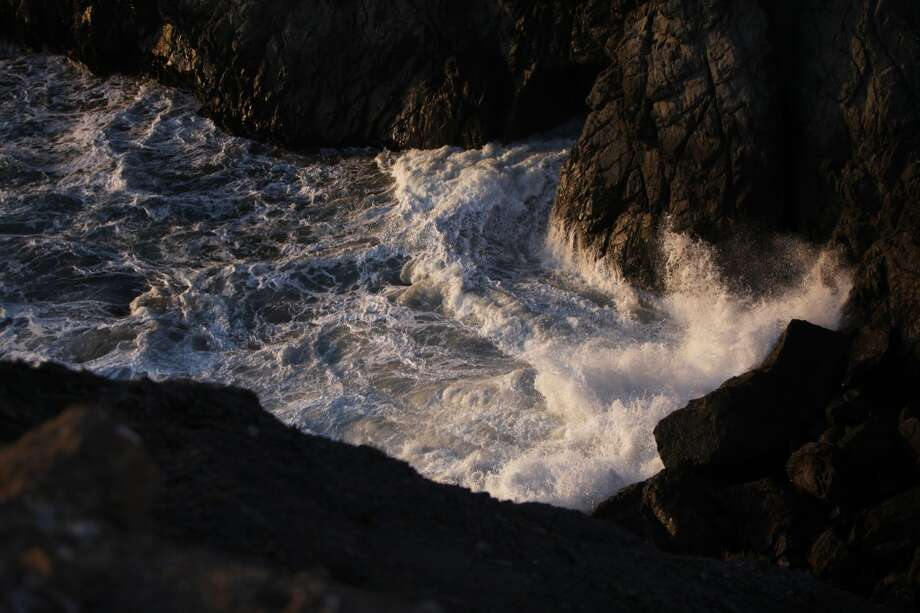 Waves crash on rocks between Dead Man's Point and Lands End on May 2, 2013 in the Lincoln Heights area of San Francisco, Calif.