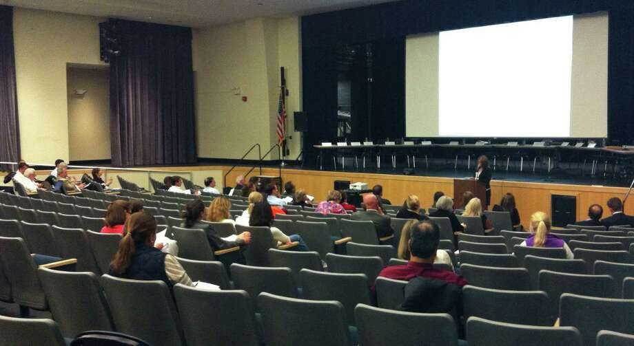 Parents and school officials take in a presentation on the proposed revised math curricuulm for grades six through 10 during Tuesday night's Board of Education meeting. Photo: Michael C. Juliano/Staff Photo