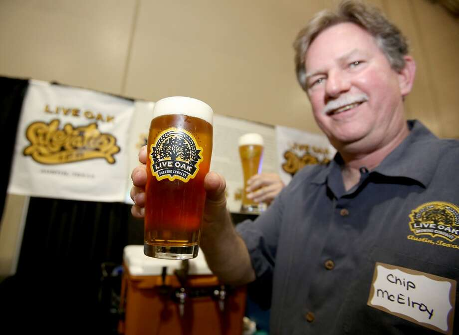 Live Oak owner and brewmaster Chip McElroy displays a freshly poured draft.