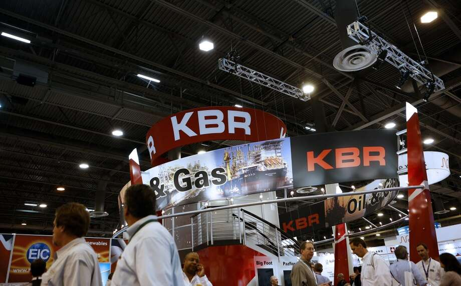 Attendees visit the KBR Inc. booth during the 2013 Offshore Technology Conference (OTC) in Houston, Texas, U.S., on Tuesday, May 7, 2013. The Offshore Technology Conference (OTC) is organized and operated to promote and further the advance of scientific and technical knowledge of offshore resources and environmental matters. Photographer: Aaron M. Sprecher/Bloomberg Photo: Aaron M. Sprecher, Bloomberg