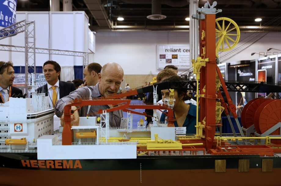 Attendees view a model of Heerema Group's AEGIR ship during the 2013 Offshore Technology Conference (OTC) in Houston, Texas, U.S., on Tuesday, May 7, 2013. The Offshore Technology Conference (OTC) is organized and operated to promote and further the advance of scientific and technical knowledge of offshore resources and environmental matters. Photographer: Aaron M. Sprecher/Bloomberg Photo: Aaron M. Sprecher, Bloomberg