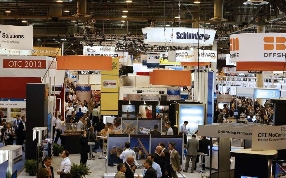 Attendees visit booths during the 2013 Offshore Technology Conference (OTC) in Houston, Texas, U.S., on Tuesday, May 7, 2013. The Offshore Technology Conference (OTC) is organized and operated to promote and further the advance of scientific and technical knowledge of offshore resources and environmental matters. Photographer: Aaron M. Sprecher/Bloomberg Photo: Aaron M. Sprecher, Bloomberg
