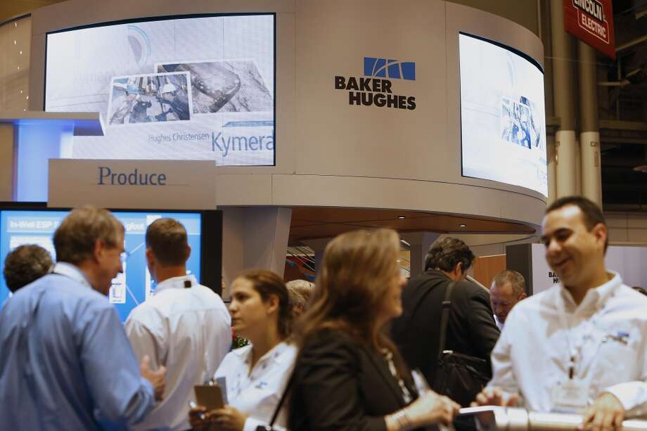 Attendees visit the Baker Hughes Inc. booth during the 2013 Offshore Technology Conference (OTC) in Houston, Texas, U.S., on Tuesday, May 7, 2013. The Offshore Technology Conference (OTC) is organized and operated to promote and further the advance of scientific and technical knowledge of offshore resources and environmental matters. Photographer: Aaron M. Sprecher/Bloomberg Photo: Aaron M. Sprecher, Bloomberg