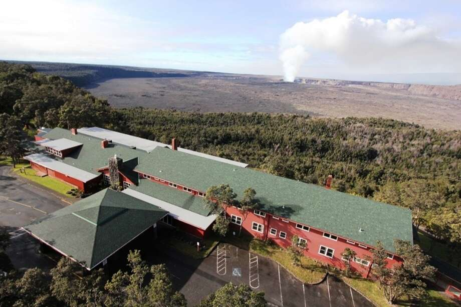 An aerial view of the Volcano House, closed for renovations at the end of 2009 and celebrating its official  reopening June 1. Flames from its original lava rock fireplace will illuminate a bronze sculpture of volcano goddess Pele in the Grand Lounge, while picture windows in the nearby sitting room offer sweeping views of Halemaʻumaʻu Crater in Hawaiʻi Volcanoes National Park.