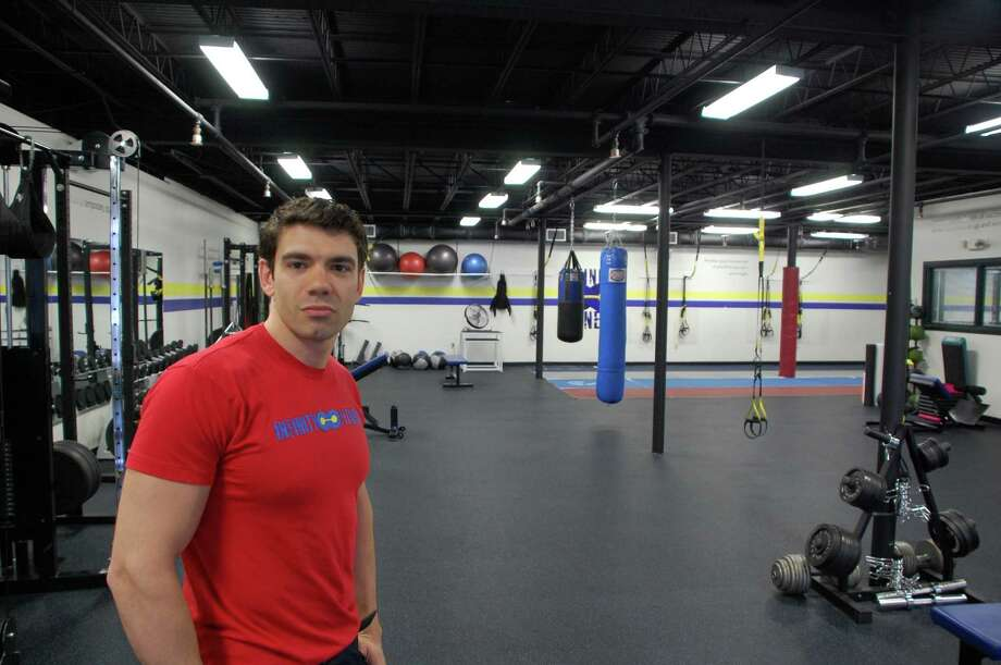 David Peterson, who began his interest in fitness and training during his junior year in high school, now owns two  Infinity Fitness gyms in Darien and New Canaan. Jarret Liotta/For the New Canaan News Photo: Contributed