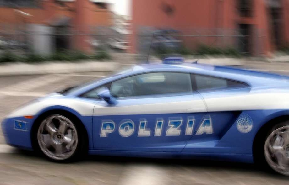 "The ""Lamborghini Gallardo"" police Car in Rome 16 December 2004. The supercar, bearing State Police colors has a 10 cylinder, 5 liters, 500 hp engine and is equipped with a full aluminum body, will be used by the traffic police during emergencies and alarm situations on the  Salerno-Reggio Calabria highway. The vehicle also has advanced technological apparatus for receiving and transmitting information and images relating to particularly critical situations."