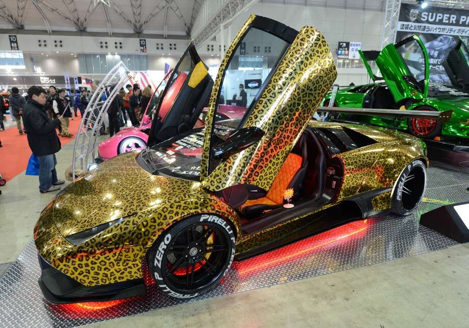 An animal-pattern-designed Lamborghini Murcielago is displayed during the Tokyo Auto Salon 2013 exhibition at the Makuhari Messe in Chiba on January 11, 2013.