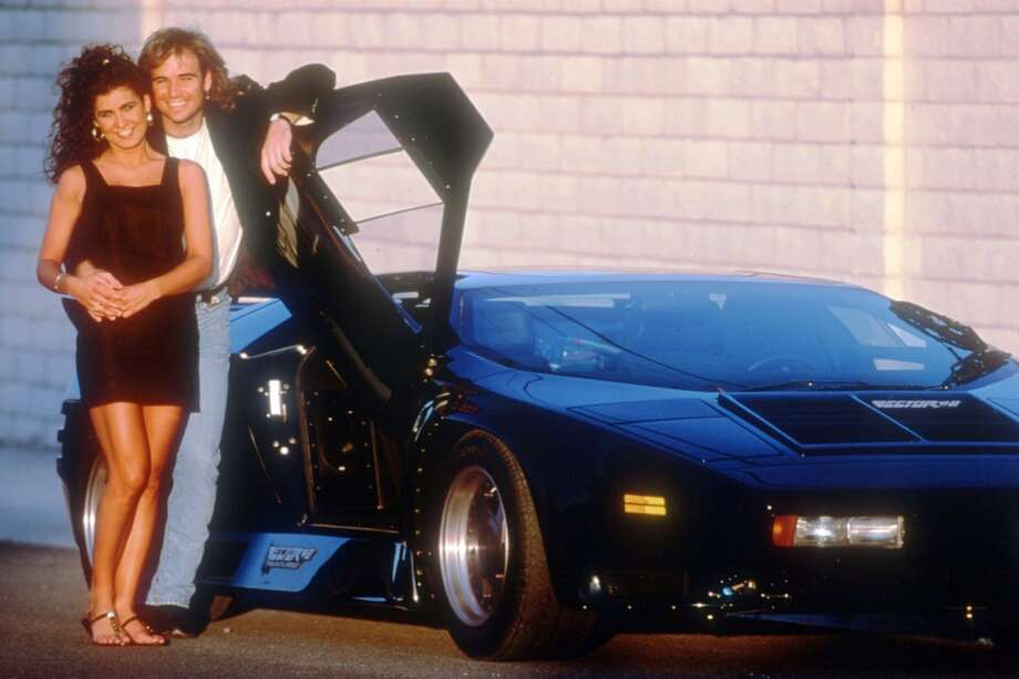 Tennis player Andre Agassi poses with his girlfriend Wendi Stewart in 1991.