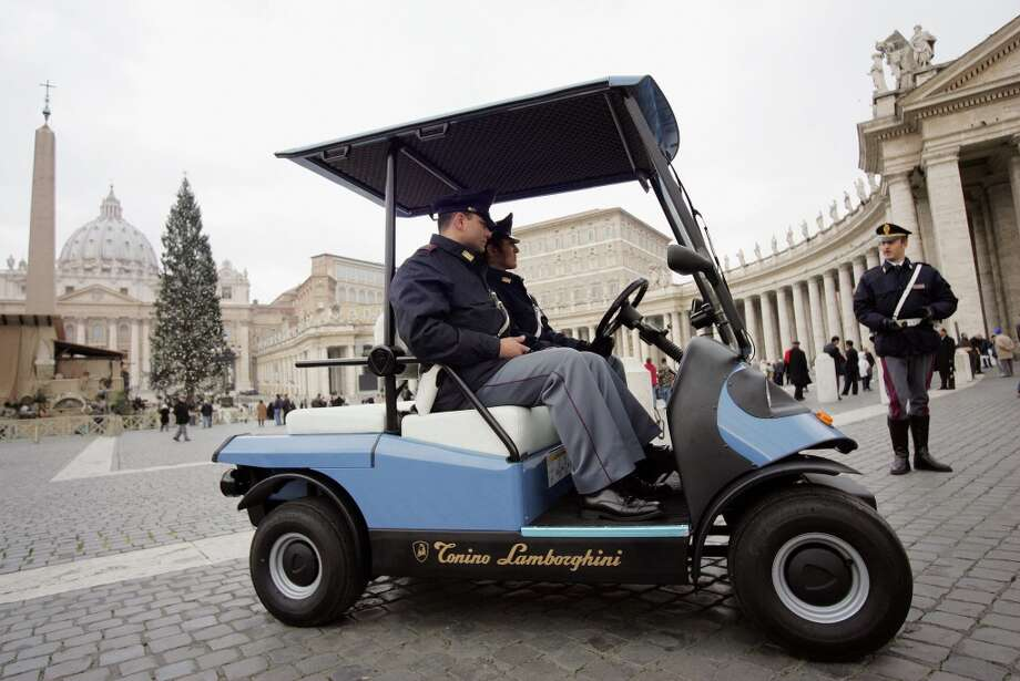 Two Italian State Policemen drive the new 'Lamborghini street model' police mini-car in St-Peter's square at the Vatican 24 December 2004. The Italian State police operating in the Vatican district will use this electric eco-friendly mini-car during patrol service.