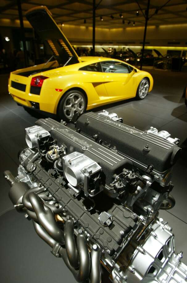 The Lamborghini Murcielago engine stands on display in the foreground with the Lamborghini Gallardo in background at the 2005 Los Angeles Auto Show January 5, 2005 in Los Angeles.