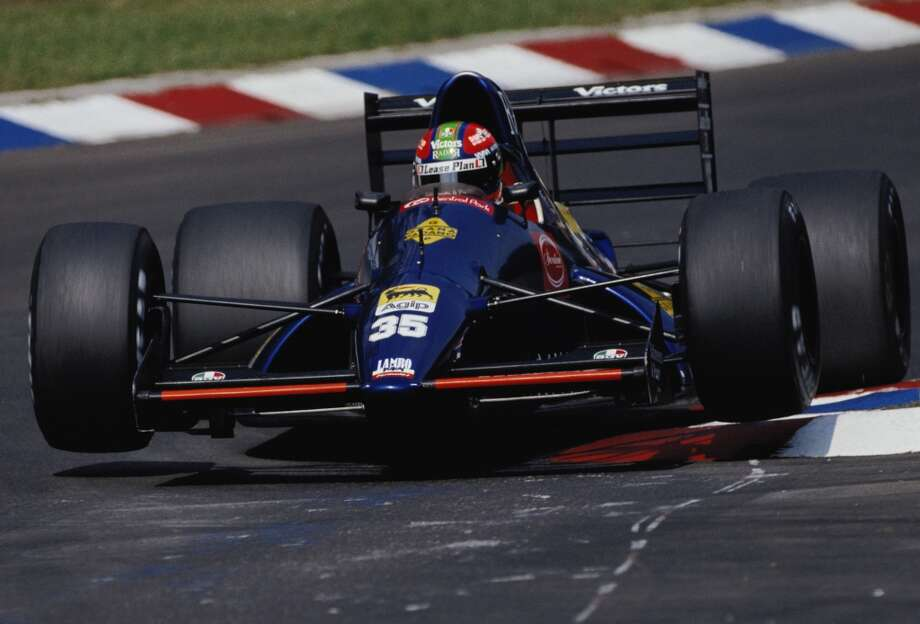 Eric van de Poele drives the #35 Modena Team SpA Lambo 291 Lamborghini 3.5 V12  over the curbs during practice for the Mobil 1 German Grand Prix on 27th July 1991 at the Hockenheimring Circuit in Hockenheim, Germany.