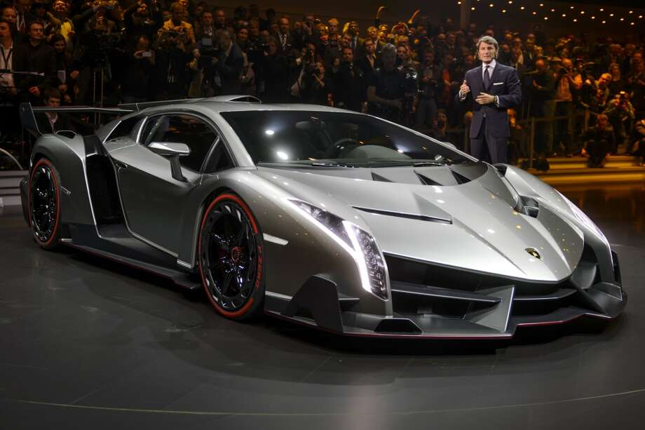 The new Lamborghini Veneno is presented by CEO and Chairman Stephan Winkelmann during a preview of Volkswagen Group on March 4, 2013 ahead of the Geneva Car Show in Geneva.