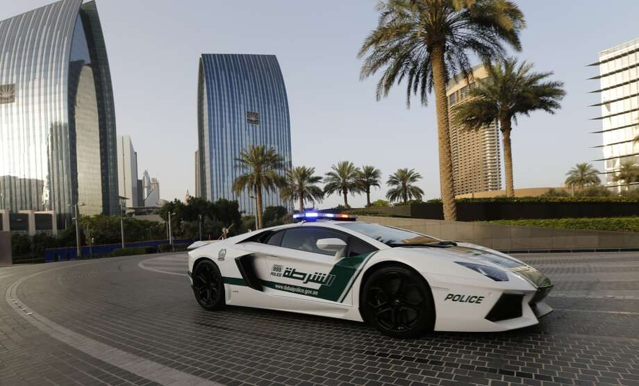 Emirati policemen patrol in an especially modified Lamborghini Aventador on April 16, 2013 in the Gulf emirate of Dubai. The introduction of the sports car, which can reach speeds of up to 349 km/h (217 mph), aims to make justice quicker on Dubai's dangerous highways.