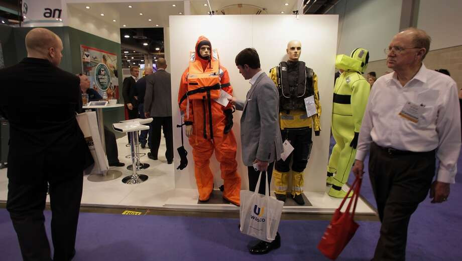 A man looks over immersion suits on display the the Viking Life-Saving Equipment booth during OTC 2013 at Reliant Park Tuesday, May 7, 2013, in Houston. ( James Nielsen / Houston Chronicle ) Photo: Houston Chronicle