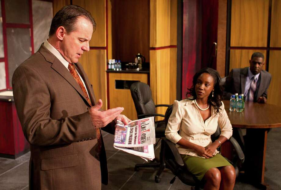 Left to right, Jack Lawson, played by Kevin Daugherty, Discusses what a client was wearing as he talks to Susan, played by Joy Brunson during a dress rehearsal of the play Race, Wednesday, May 1, 2013, in The Ensemble Theatre in Houston. ( Nick de la Torre / Chronicle ) Photo: Nick De La Torre, Staff / © 2013 Houston Chronicle