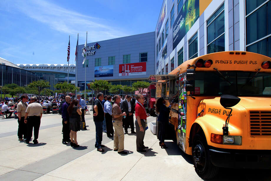 Attendees stand in line for food from Bernie's Burger Bus, during day two of the Offshore Technology Conference at Reliant Center Tuesday, May 7, 2013, in Houston. Photo: Cody Duty, Houston Chronicle / © 2013 Houston Chronicle