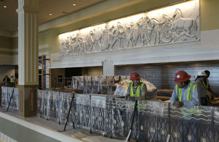 A relief sculpture on the mezzanine level was hand crafted by a Dallas-based artist.