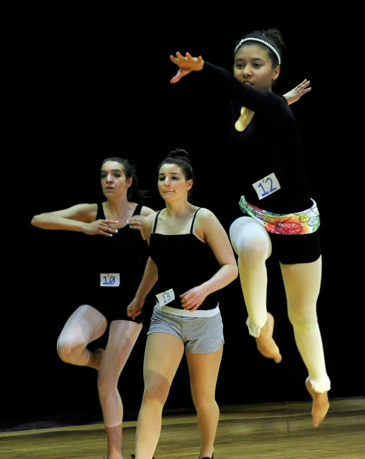 Desiree Pratt, right, goes into a leap during Tuesday's audition. Connecticut Ballet has joined forces with Khalda Logan Memorial Foundation to provide foundational training and accelerated training opportunities for aspiring Danbury dance students. Interested dancers audition for a talent-based dance scholarships Monday, May 6, 2013, at Broadview Middle School in Danbury, Conn. Photo: Carol Kaliff / The News-Times