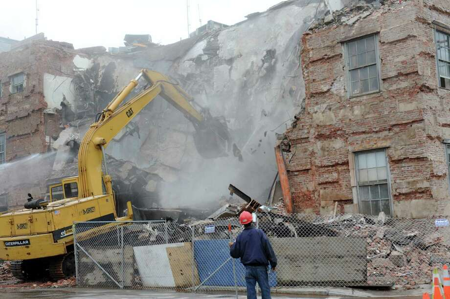 The demolition of the Central Fire Station at 15 Havemeyer Place, in Greenwich Wednesday, May 8,2013. Photo: Helen Neafsey / Greenwich Time