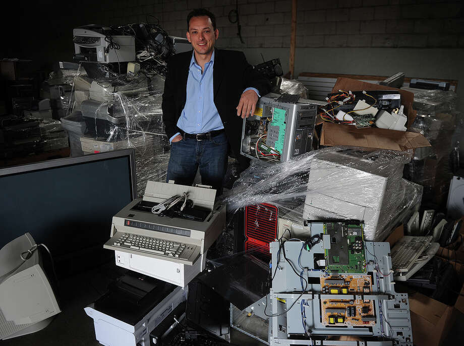 Will Macca of Milford offers individuals and corporations a way to recycle unwanted electronics at his company, FEW.R Corp. at 164 Old Gate Lane in Milford on Wednesday, May 8, 2013. Photo: Brian A. Pounds / Connecticut Post