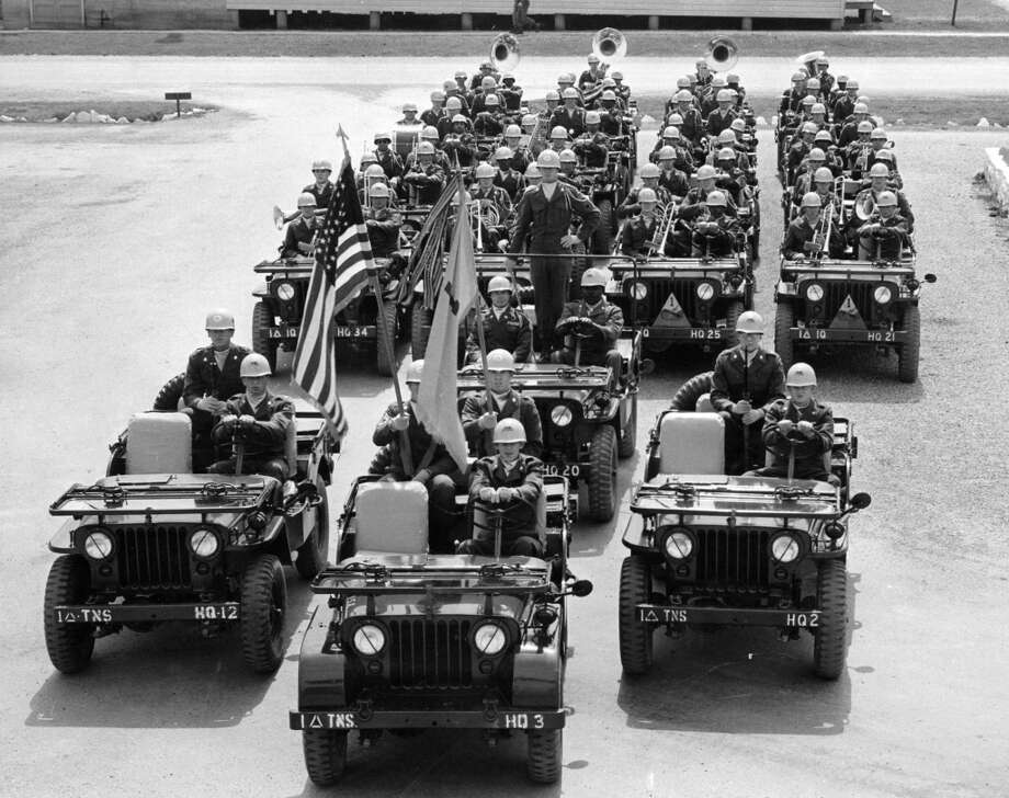 Splash Day 1955 - U.S. Army First Armored Division's 46-Man Jeep Band. The Fort Hood unit is on their way to perform in Splash Day events.