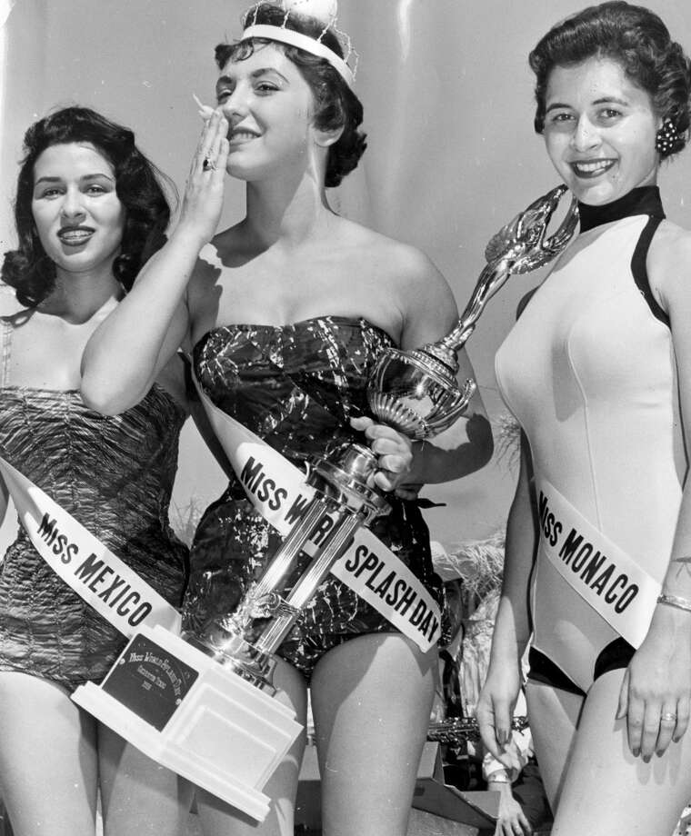 05/06/1956 - Anna Laura Smith, center, is Miss World Splash Day: Runners up are Sonia Ibarra, left, and Gerry Ann Benham, right. Published May 7, 1956.