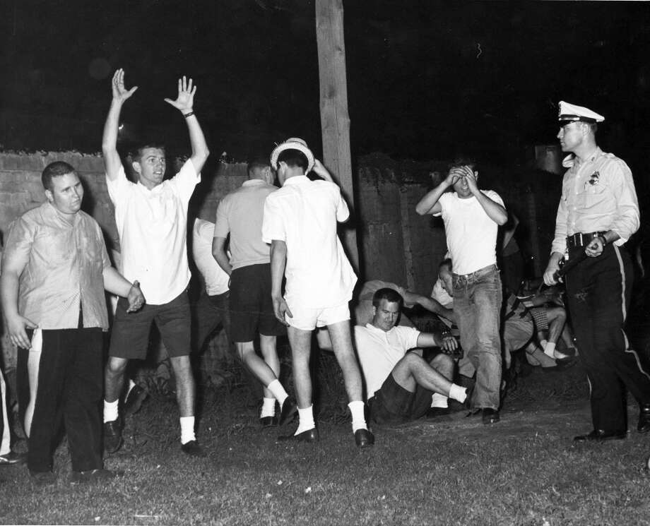 04/29/1961 - Youths, mostly college students, picked up and taken to jail after a near-riot during Splash Day activities on Galveston Island.