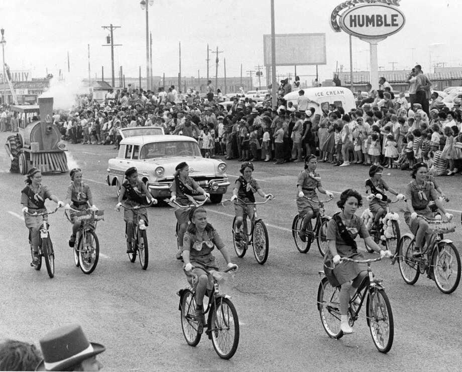Galveston Girl Scouts keep the lines straight, lending a young touch to the Splash Days parade. Published April 30, 1961