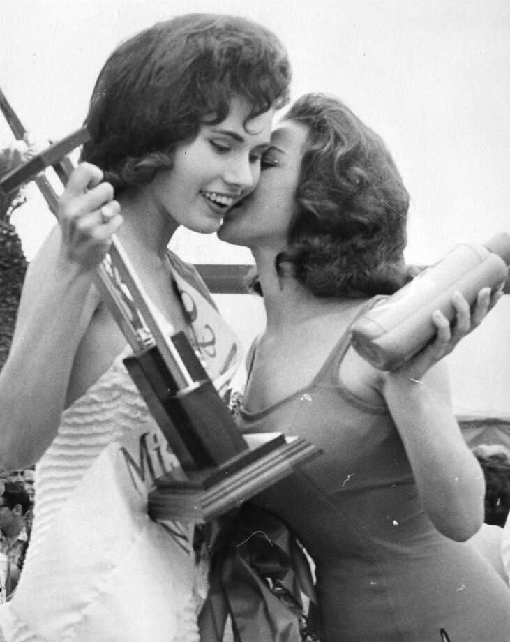 Miss Splash Day of 1962, left, gets a kiss from Miss Splash Day 1961. April 29, 1962.