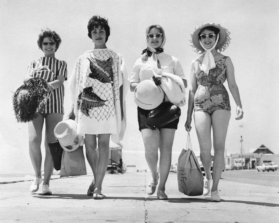 04/1962 - Four students from East Texas State College add to the scenery along the Seawall in Galveston. The girls are, from left, Betty Koepp of Ft. Worth; Katchy Black of Greenville, Sara Jenkins of Hughes Springs, and Jeannie Smith of Daingerfield. Published April 29, 1962.