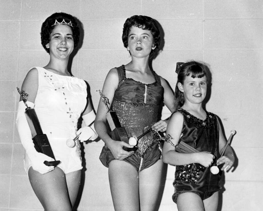 Winners of Splash Days twirling championships show their trophies. The girls, all from Galveston, are, from left, Joyce Ervin, 15 years and up division; Marsha Seal, 10-14, and Jeannie Franken, up to 9. Published April 29, 1962.