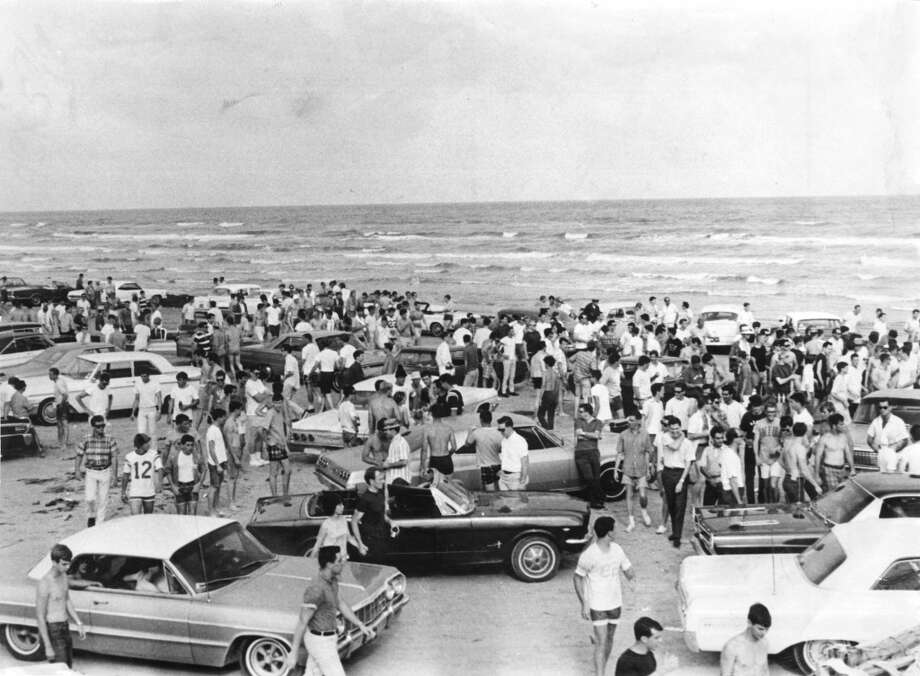 Thousands of students on Galveston's East Beach. Law used clubs and tear gas to disperse jeering students. Published May 1, 1966.