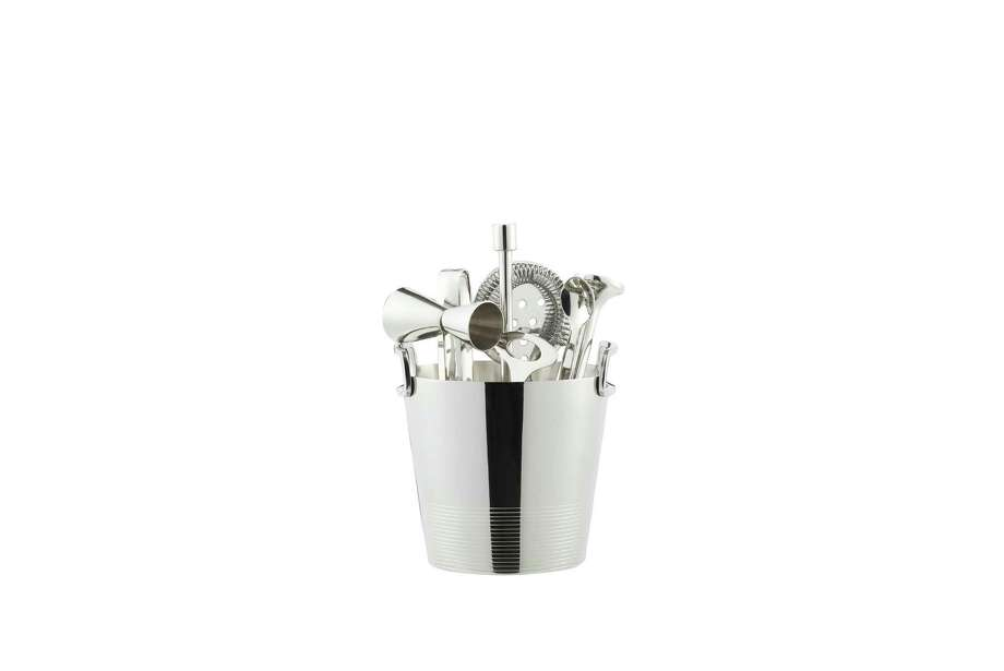 Bottom's up: Prohibition-era cocktails such as a Bee's Knees or a Sidecar call for a proper pour — keep your drinks dapper with Crate & Barrel's elegant collection of stainless steel servingware. Bar tools and ice bucket; $59.95 at www.crateandbarrel.com.