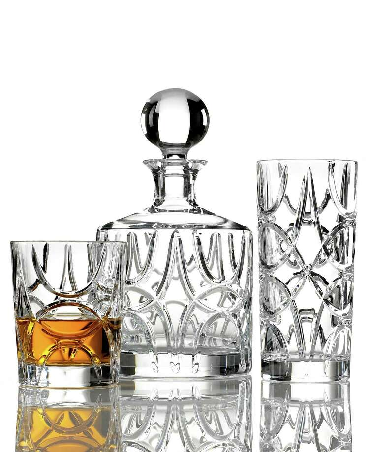 Crystal clear:Even bathtub gin looks classy in crystal cocktail glasses, particularly when they're etched with interlocking geometric arches that recall art deco design in the Royalton collection by Lauren Ralph Lauren; $60-$140 at Macy's.
