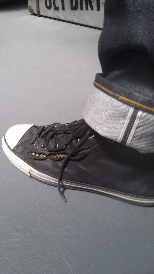 Jon Tappan of Converse says the casually well-dressed man sports a John Varvatos leather-and-zipper sneaker.